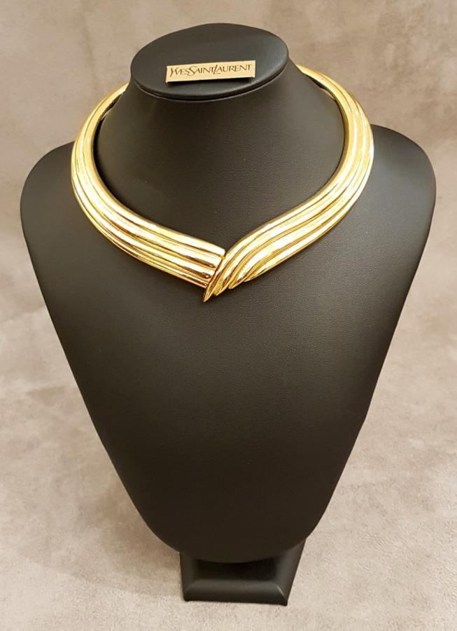 YVES SAINT LAURENT   Golden metal torque necklace, More Informations...